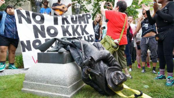 eua-manifestantes-derrubam-estatua-de-soldado-co-1